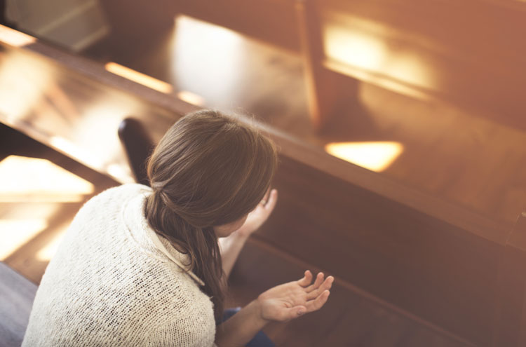 woman worshipping alone - is speaking in tongues for today?