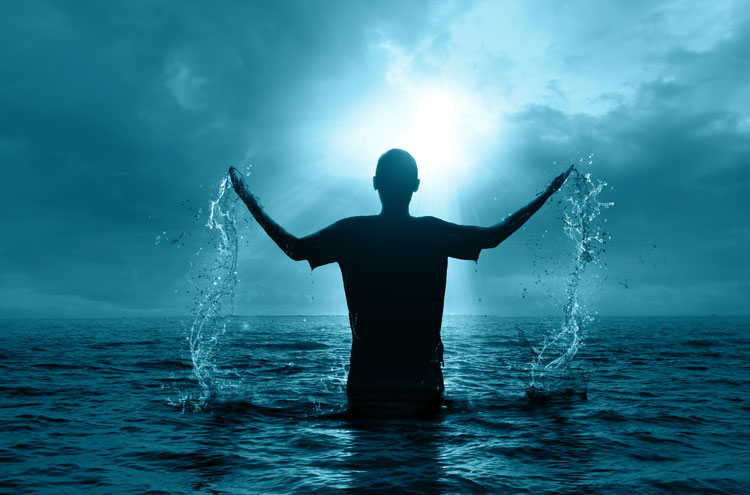 man being baptized, emerging from water