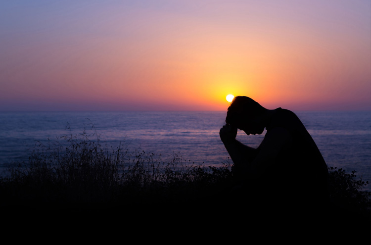 Man praying next to sunset - Have you prayed to speak in tongues but still are unable?