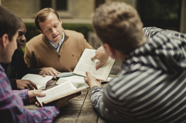 Men looking at their Bibles - which Bible translation should I be using?