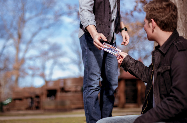 Evangelist handing out gospel tract - Should you persuade people to accept Jesus as their personal Savior?