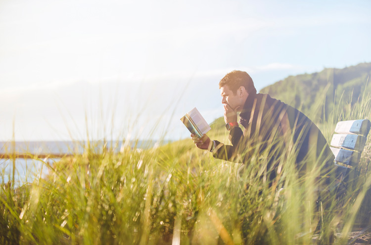 Man reading book, pondering - Is your salvation conditional or unconditional?