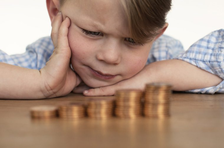 Child counting money - What do disciples of Jesus do with their money?