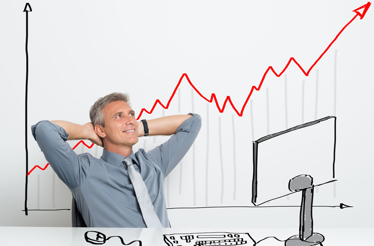 Man leaning back at computer - Is it wrong to invest in the stock market