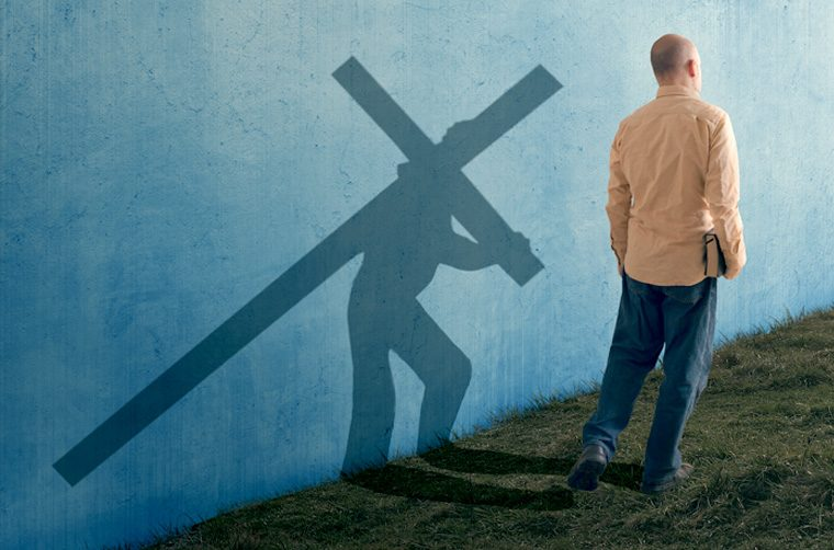 Man carrying cross - Are you a true disciple or a false disciple of Jesus Christ?