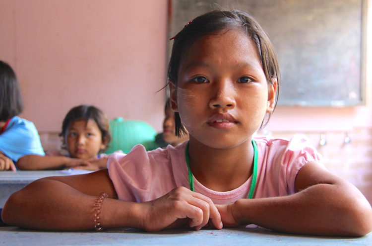 Picture of child at desk - Should you sponsor a child?
