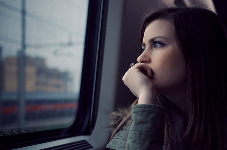 Woman looking out window - How do you find significance in your life?