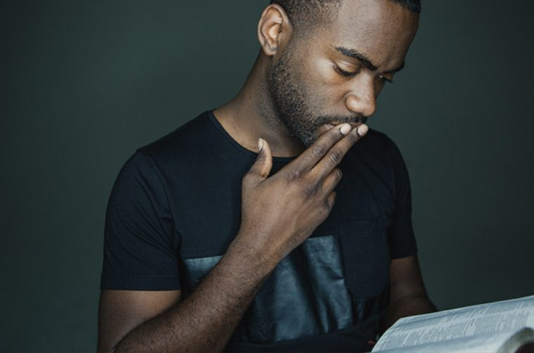 Man reading Bible - Was the Apostle Peter a Calvinist?