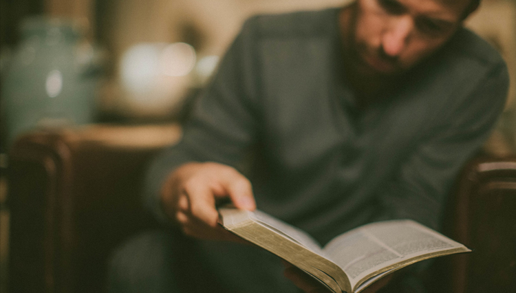 Picture of Christian man reading Old Testament in his Bible