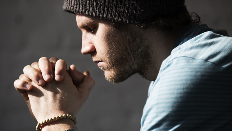 Picture of young man praying - what is the cure for lust?