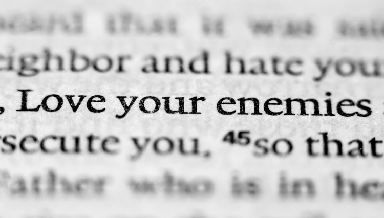 "Picture of Bible opened to verse, ""Love your enemies."""