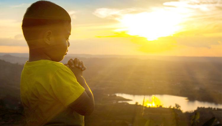Little boy making prayer requests