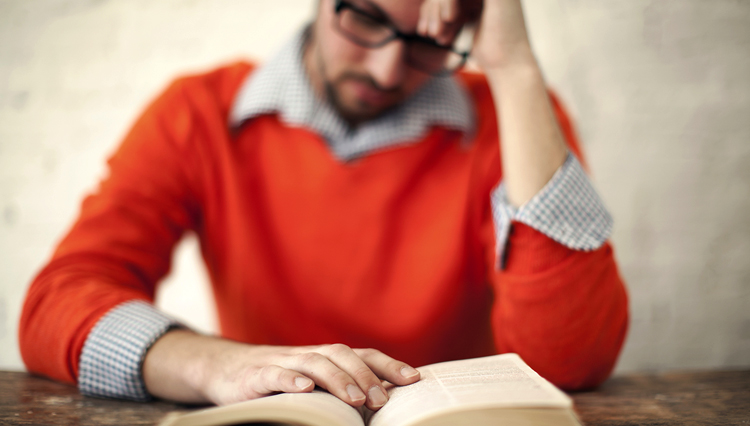 Picture of man reading Bible and thinking about forgiveness