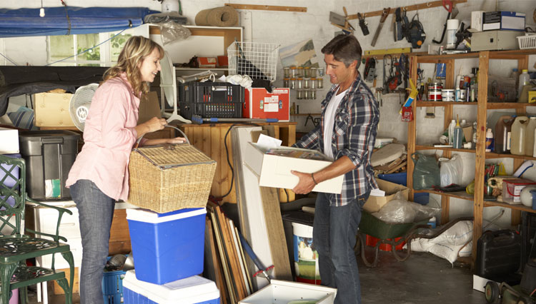 Picture of husband and wife sorting through things / treasures in the garage