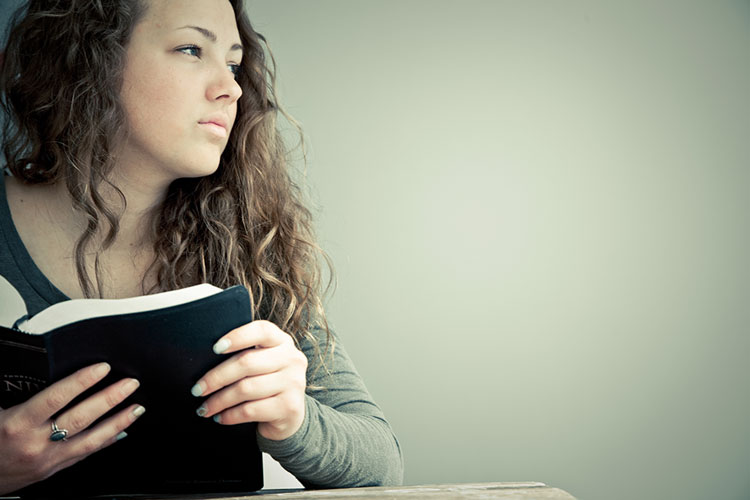 Young lady reading her Bible