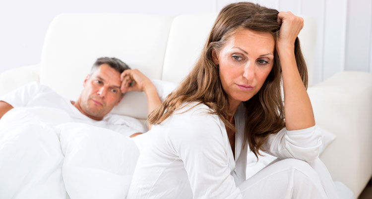 Married Couple in bed frustrated