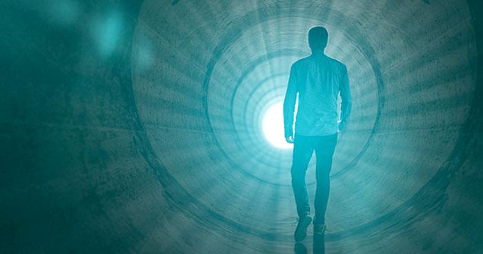 Man walking towards light during near death experience