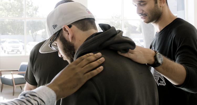 Praying for man to be healed