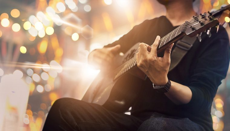 Picture of a man playing guitar